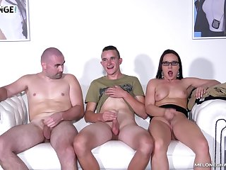 Wendy Moon seduces two guys and sucks their cocks on the couch