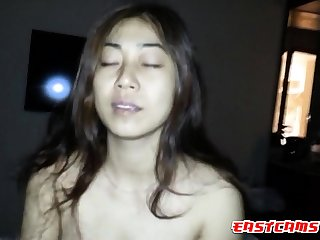 Busty Vietnamese chick riding cock in cowgirl position