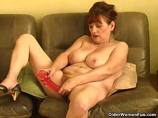 Old granny with big tits pushing dildo up her pussy